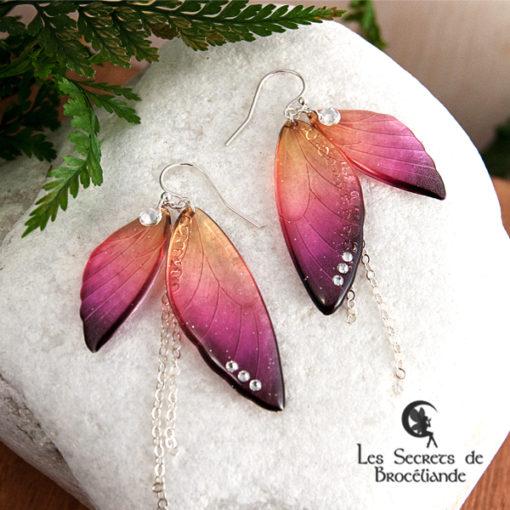 Boucles ailes de fée de couleur prune et orange en résine, monture en argent 925. Fabrication artisanale.