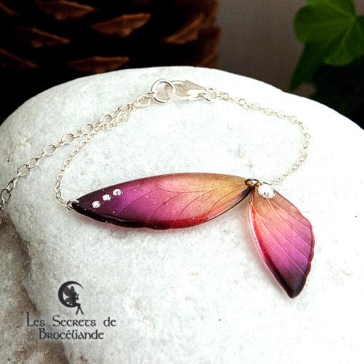 Bracelet ailes de fée de couleur prune et orange en résine, monture en argent 925. Fabrication artisanale.
