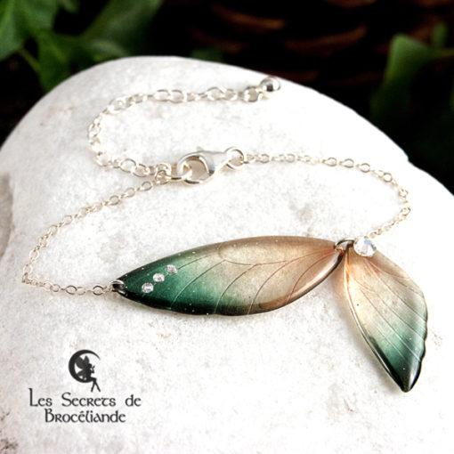 Bracelet ailes de fée de couleur vert et or en résine, monture en argent 925. Fabrication artisanale.