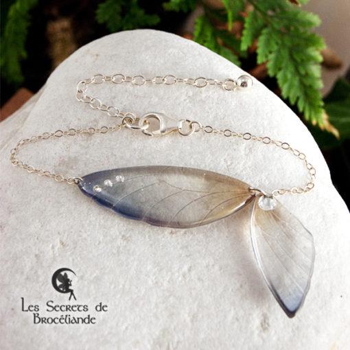Bracelet ailes de fée de couleur bleu et ocre en résine, monture en argent 925. Fabrication artisanale.