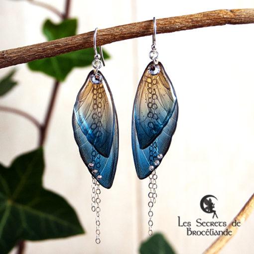 Boucles ailes de fée de couleur bleu et or en résine, monture en argent 925. Fabrication artisanale.